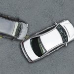 Aerial photo of two cars in a minor accident